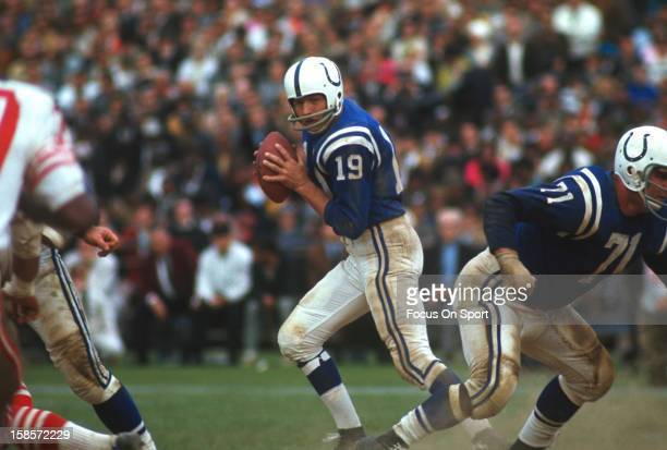 Quarterback Johnny Unitas of the Baltimore Colts drops back to pass against the San Francisco 49ers during an NFL football game circa 1967 at...