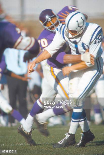 Quarterback Johnny Unitas of the Baltimore Colts gets his pass off under pressure from Jim Marshall of the Minnesota Vikings during an NFL football...