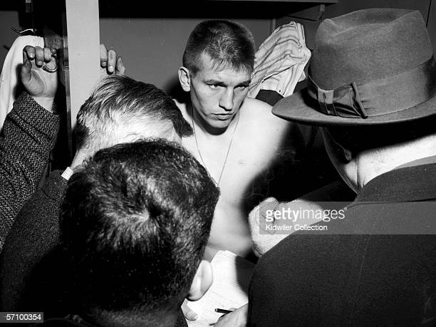 Quarterback Johnny Unitas of the Baltimore Colts is interviewed in the lockerroom after the NFL Championship Game on December 28 1958 against the New...