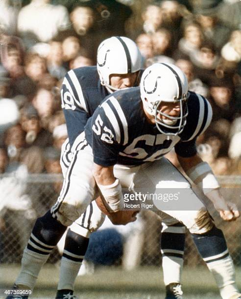 Quarterback Johnny Unitas of the Baltimore Colts receives the ball from center Dick Szymanski during their game circa 1963