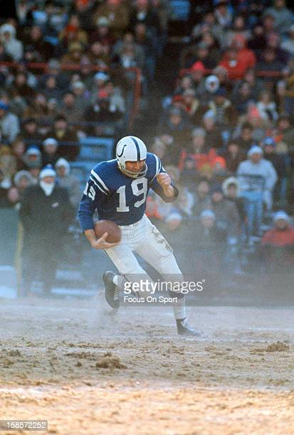 Quarterback Johnny Unitas of the Baltimore Colts scrambles with the ball during an NFL football game circa 1970 at Memorial Stadium in Baltimore...