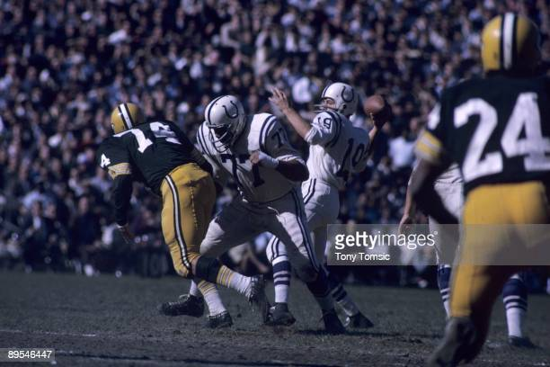 Quarterback Johnny Unitas of the Baltimore Colts sets up to pass the ball as Jim Parker blocks for him during a game on October 18 1964 against the...