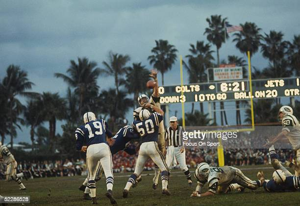 Quarterback Johnny Unitas of the Baltimore Colts throws a pass as a New York Jets linebacker goes up in an attempt to block the pass during Super...