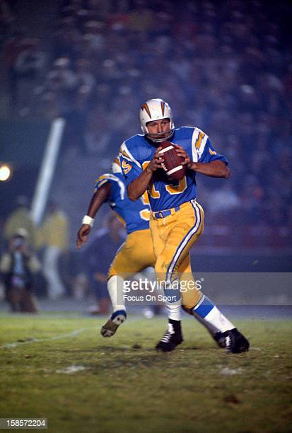 Quarterback Johnny Unitas of the San Diego Charger drops back to pass against the Los Angeles Rams during a preseason NFL football game circa 1973 at...