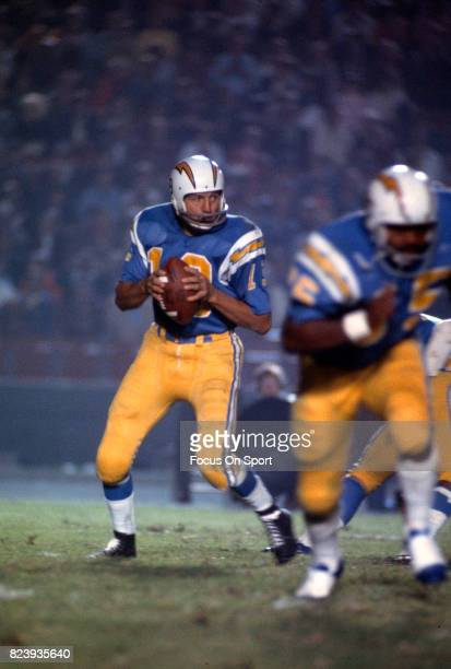 Quarterback Johnny Unitas of the San Diego Charger drops back to pass against the Los Angeles Rams during an NFL football game circa 1973 at Jack...