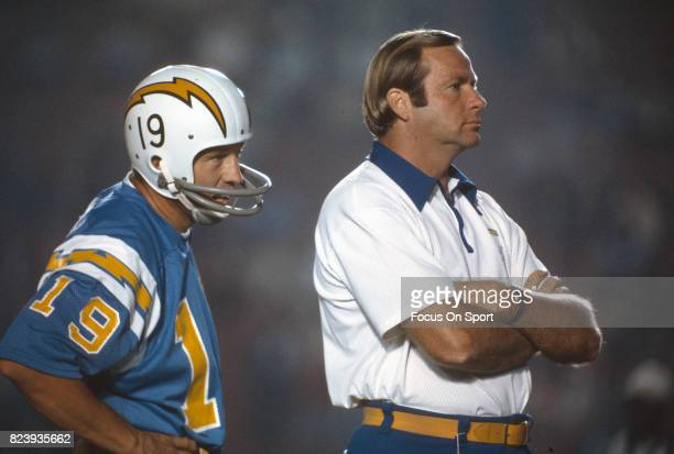 Quarterback Johnny Unitas of the San Diego Charger looks on from the sidelines during an NFL football game against the Los Angeles Rams circa 1973 at...
