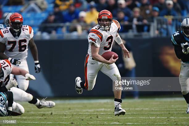 Quarterback Jon Kitna of the Cincinnati Bengals advances the ball during the NFL game against the Carolina Panthers at Ericsson Stadium on December 8...