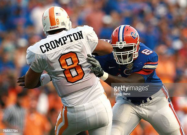 Quarterback Jonathan Crompton of the Tennessee Volunteers is hit by defensive end Carlos Dunlap of the Florida Gators after releasing a pass at Ben...