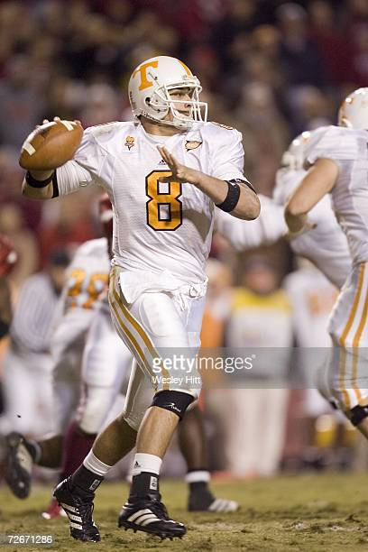 Quarterback Jonathan Crompton of the Tennessee Volunteers throws a pass against the Arkansas Razorbacks at Donald W Reynolds Stadium on November 11...