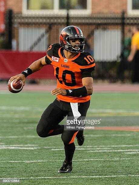 Quarterback Jonathon Jennings of the BC Lions runs with the ball during the CFL game against the Montreal Alouettes at Percival Molson Stadium on...