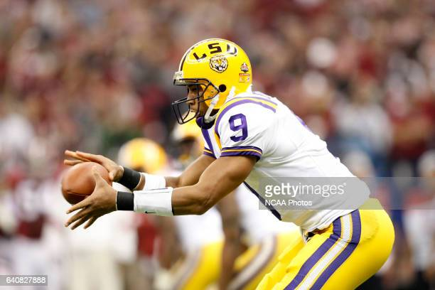 Quarterback Jordan Jefferson of Louisiana State University collects the snap against the University of Alabama during the 2012 Allstate BCS...