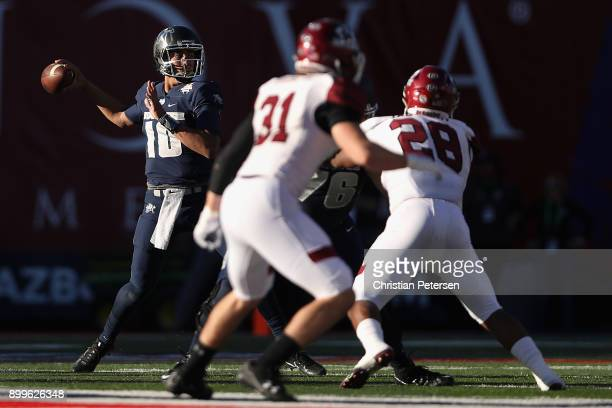 Quarterback Jordan Love of the Utah State Aggies looks to pass during the first half of the Nova Home Loans Arizona Bowl game against the New Mexico...