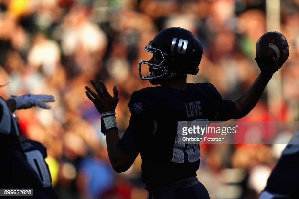 Quarterback Jordan Love of the Utah State Aggies throws a pass during the first half of the Nova Home Loans Arizona Bowl game against the New Mexico...