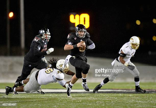 Quarterback Jordan Lynch of the Northern Illinois Huskies runs for 36 yards and a touchdown during the second quarter against the Western Michigan...