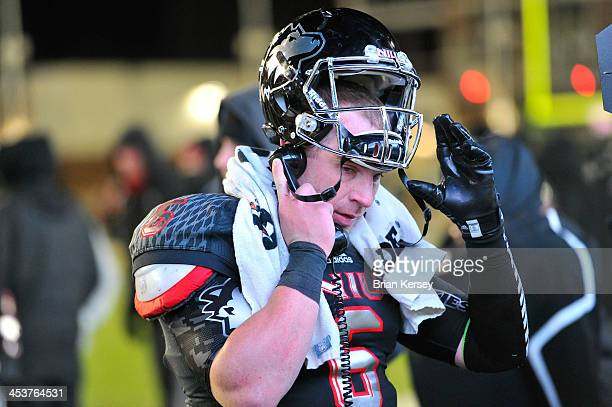 Quarterback Jordan Lynch of the Northern Illinois Huskies stands on the sidelines as the defense is on the field during the fourth quarter against...