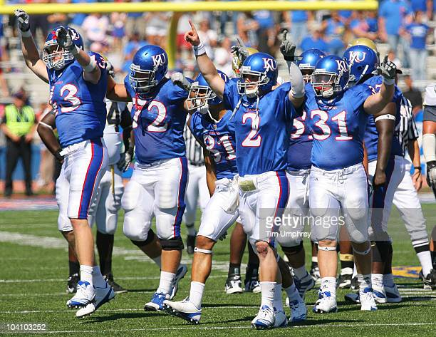 Quarterback Jordan Webb and the Kansas Jayhawks celebrate after winning a game against the Georgia Tech Yellow Jackets on September 11 2010 at...
