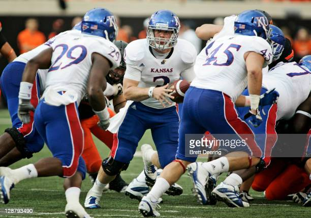 Quarterback Jordan Webb of Kansas University looks to hand off during the first half against Oklahoma State October 8 2011 at Boone Pickens Stadium...