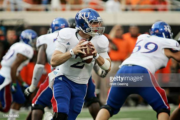 Quarterback Jordan Webb of Kansas University looks to throw in the first half against Oklahoma State on October 8 2011 at Boone Pickens Stadium in...