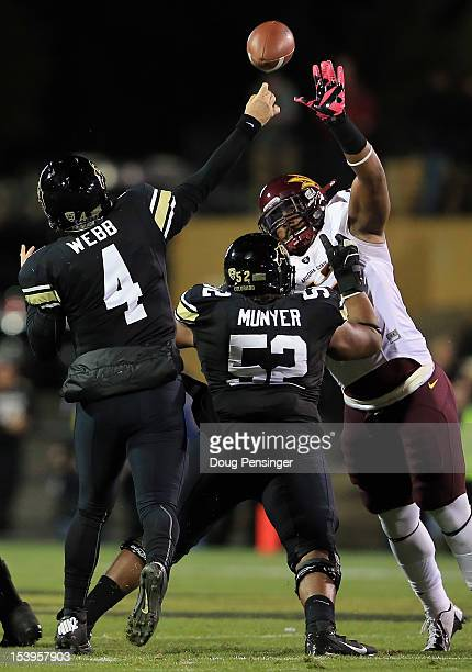 Quarterback Jordan Webb of the Colorado Buffaloes delivers a pass against defensive tackle Will Sutton of the Arizona State Sun Devils as offensive...