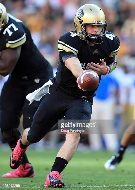 Quarterback Jordan Webb of the Colorado Buffaloes hands the ball off against the UCLA Bruins at Folsom Field on September 29 2012 in Boulder Colorado