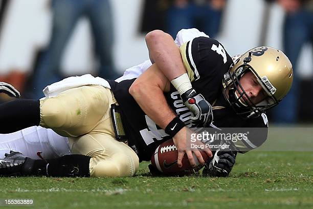 Quarterback Jordan Webb of the Colorado Buffaloes is sacked by inebacker Chase Thomas of the Stanford Cardinal at Folsom Field on November 3 2012 in...