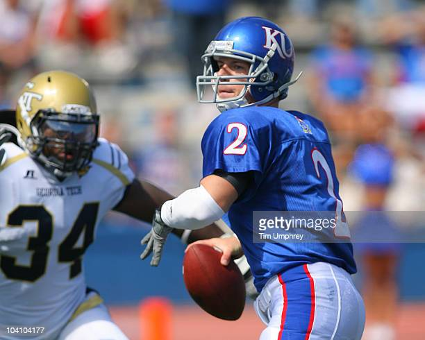 Quarterback Jordan Webb of the Kansas Jayhawks drops back to pass in a game against the Georgia Tech Yellow Jackets on September 11 2010 at Memorial...