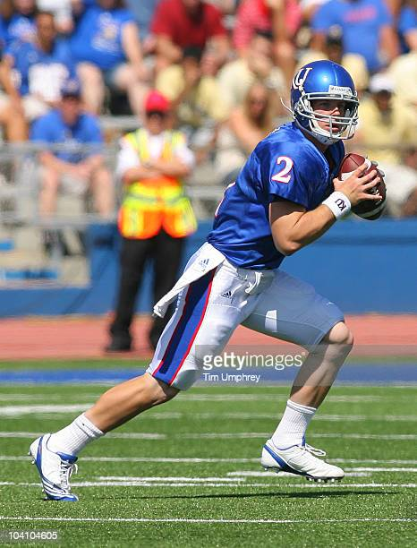 Quarterback Jordan Webb of the Kansas Jayhawks rolls out to pass in a game against the Georgia Tech Yellow Jackets on September 11 2010 at Memorial...