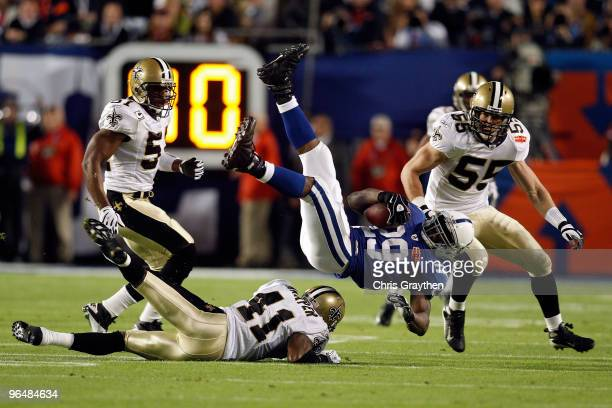 Quarterback Joseph Addai of the Indianapolis Colts is tackled by Roman Harper of the New Orleans Saints during Super Bowl XLIV on February 7 2010 at...