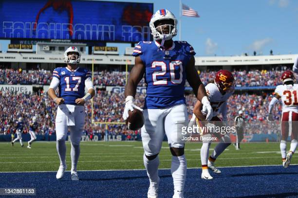 Quarterback Josh Allen and Zack Moss of the Buffalo Bills react after Moss scored a touchdown against the Washington Football Team in the second...