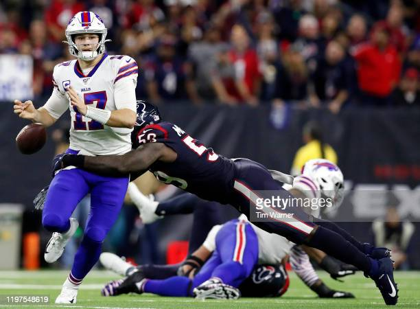 Quarterback Josh Allen of the Buffalo Bills fumbles on a sack by Whitney Mercilus of the Houston Texans in the fourth quarter of the AFC Wild Card...