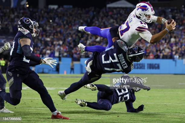 Quarterback Josh Allen of the Buffalo Bills is tackled short of the first down marker on third down by safety Amani Hooker of the Tennessee Titans...