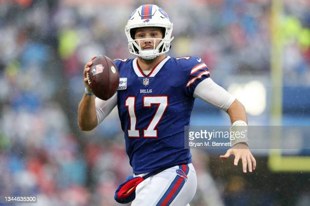 Quarterback Josh Allen of the Buffalo Bills looks to pass against the Houston Texans in the fourth quarter at Highmark Stadium on October 03, 2021 in...