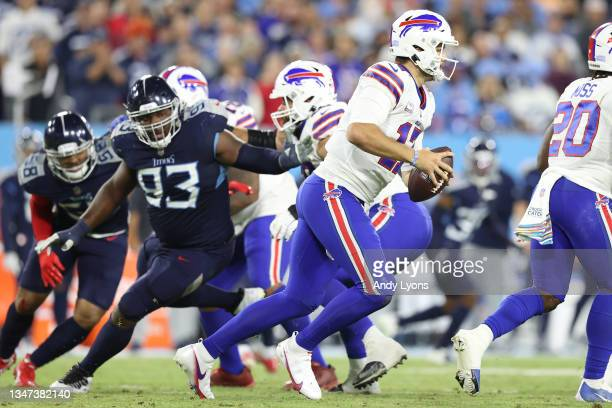 Quarterback Josh Allen of the Buffalo Bills rushes against the Tennessee Titans during the second quarter at Nissan Stadium on October 18, 2021 in...