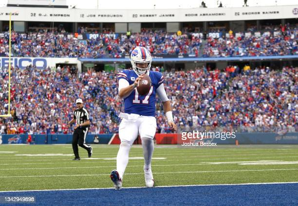 Quarterback Josh Allen of the Buffalo Bills rushes for a touchdown during the fourth quarter of the game against the Washington Football Team at...