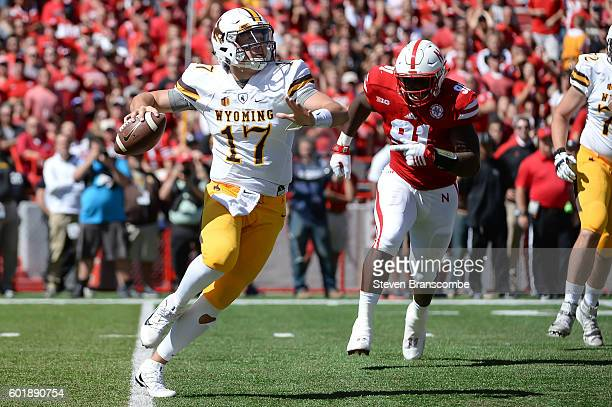 Quarterback Josh Allen of the Wyoming Cowboys passes against defensive end Freedom Akinmoladun of the Nebraska Cornhuskers at Memorial Stadium on...