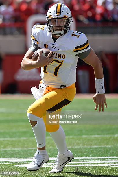Quarterback Josh Allen of the Wyoming Cowboys runs against the Nebraska Cornhuskers at Memorial Stadium on September 10 2016 in Lincoln Nebraska