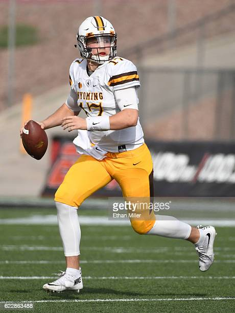 Quarterback Josh Allen of the Wyoming Cowboys scrambles before throwing a 50yard pass against the UNLV Rebels during their game at Sam Boyd Stadium...