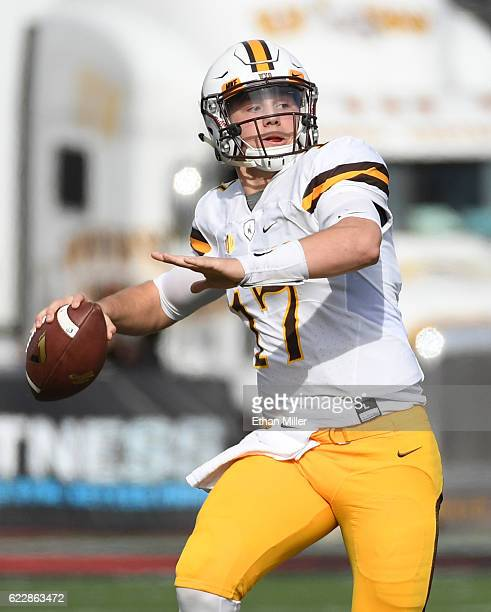 Quarterback Josh Allen of the Wyoming Cowboys throws a 50yard pass against the UNLV Rebels during their game at Sam Boyd Stadium on November 12 2016...