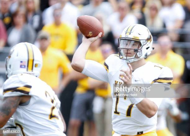 Quarterback Josh Allen of the Wyoming Cowboys throws a pass in the first quarter against the Iowa Hawkeyes on September 2 2017 at Kinnick Stadium in...