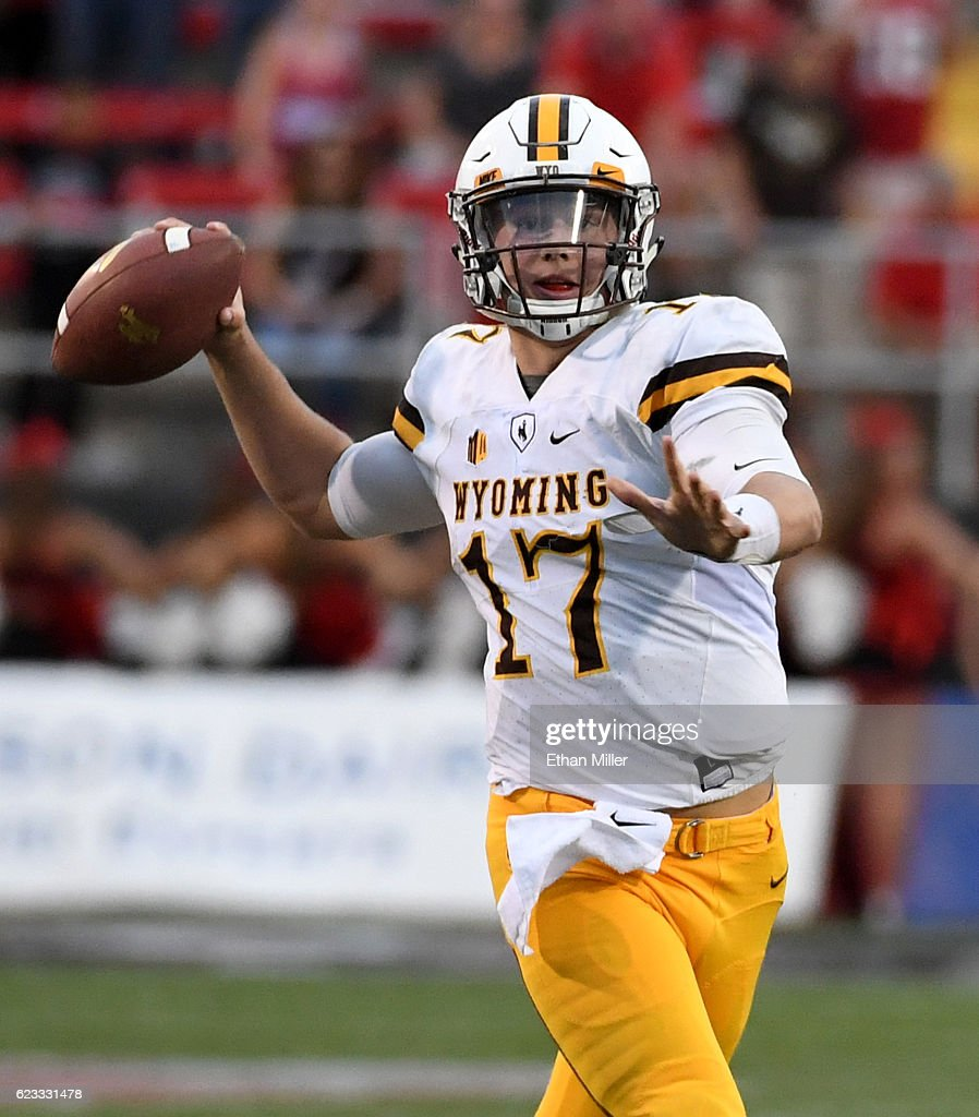 Quarterback Josh Allen #17 of the Wyoming Cowboys throws against the UNLV Rebels during their game at Sam Boyd Stadium on November 12, 2016 in Las Vegas, Nevada. UNLV won 69-66 in triple overtime.