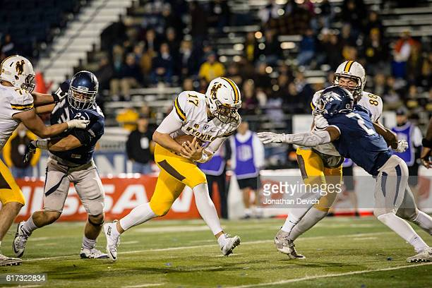 Quarterback Josh Allen of Wyoming holds onto the ball to complete a touchdown against Nevada at Mackay Stadium on October 22 2016 in Reno Nevada