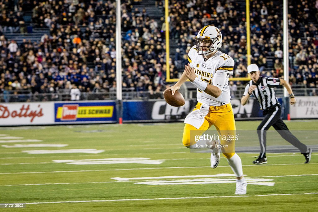 Quarterback Josh Allen #17 of Wyoming holds onto the ball to run for a touchdown against Nevada at Mackay Stadium on October 22, 2016 in Reno, Nevada.