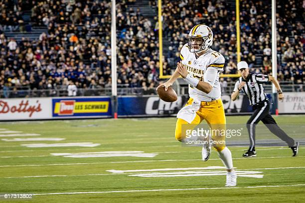 Quarterback Josh Allen of Wyoming holds onto the ball to run for a touchdown against Nevada at Mackay Stadium on October 22 2016 in Reno Nevada