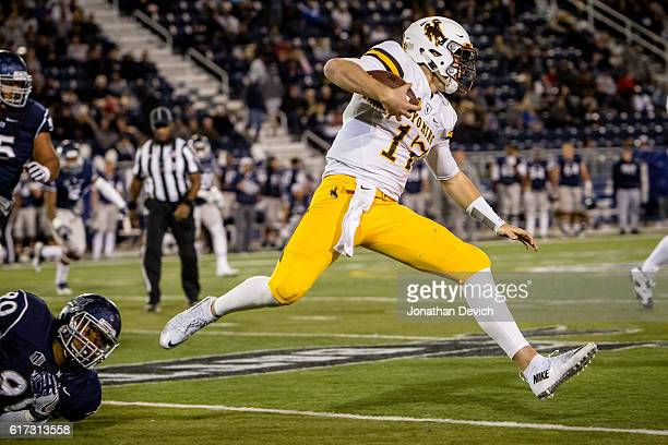 Quarterback Josh Allen of Wyoming holds onto the ball to try to make it through the Nevada defense at Mackay Stadium on October 22 2016 in Reno Nevada