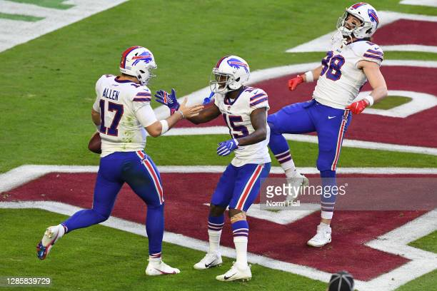Quarterback Josh Allen reacts with wide receiver John Brown and tight end Dawson Knox of the Buffalo Bills react after scoring a touchdown during the...