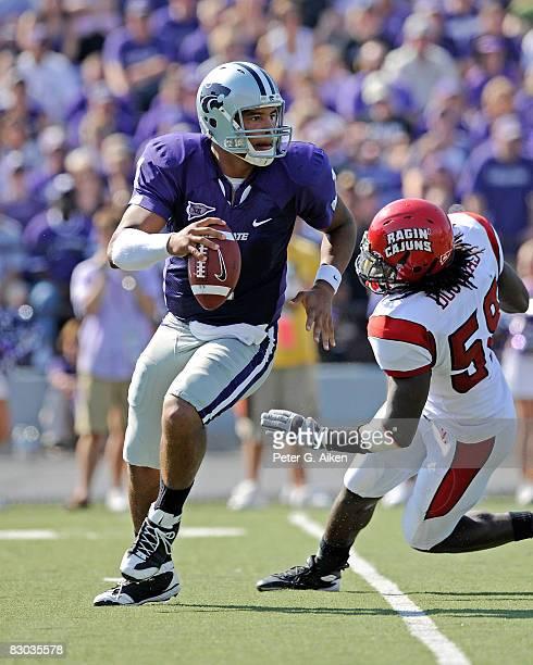 Quarterback Josh Freeman of the Kansas State Wildcats scrambles away from defensive end Nate Douglas of the Louisiana-Lafayette Ragin' Cajuns in the...