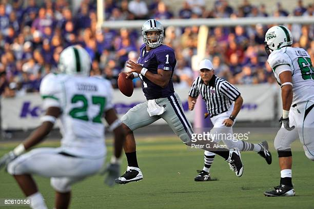 Quarterback Josh Freeman of the Kansas State Wildcats scrambles to the outside against pressure from the North Texas Mean Green defensive in the...