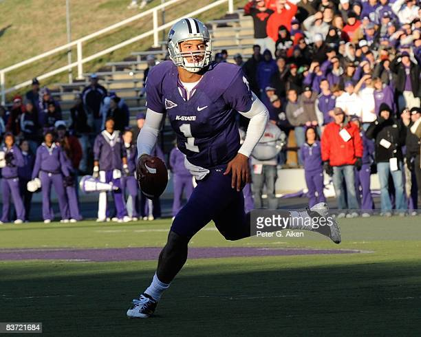 Quarterback Josh Freeman of the Kansas State Wildcats scrambles to the outside as he looks down field against the Nebraska Cornhuskers during the...