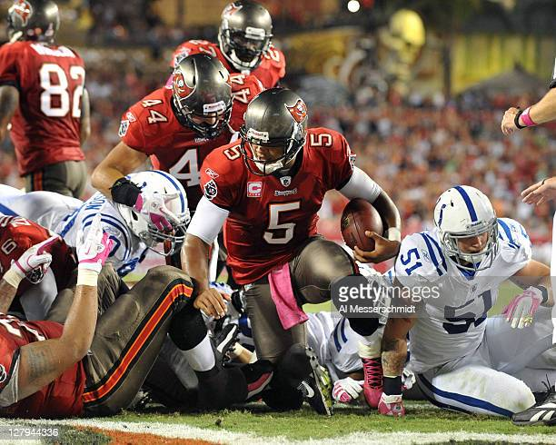 Quarterback Josh Freeman of the Tampa Bay Buccaneers runs for a touchdown against the Indianapolis Colts October 3 2011 at Raymond James Stadium in...