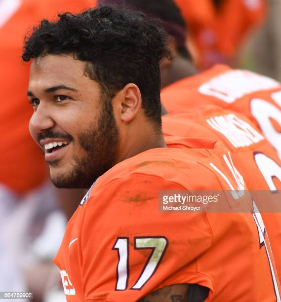 Quarterback Josh Jackson of the Virginia Tech Hokies looks on from the bench in the second half against the North Carolina Tar Heels at Lane Stadium...